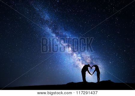 Milky Way. Man And Woman Holding Hands In Heart Shape
