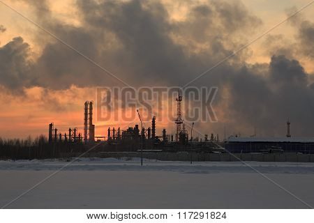 Oil Chemistry Refinery at sunset sky background in winter.