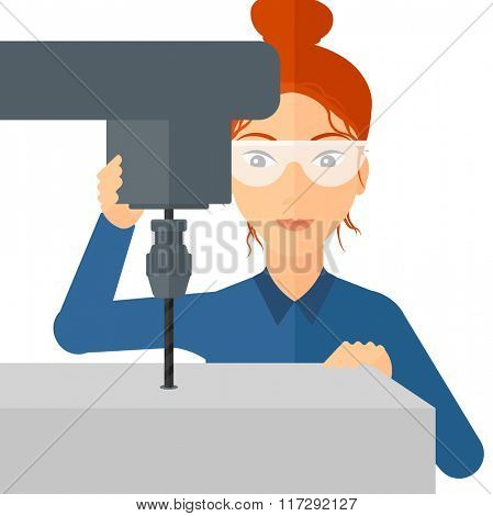 Woman working with boring mill.