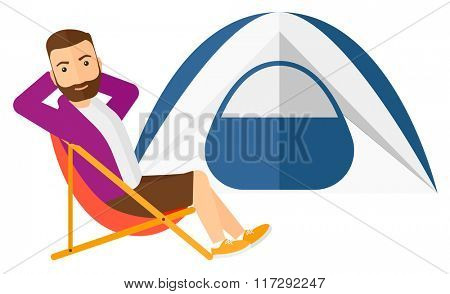 Man sitting in folding chair.