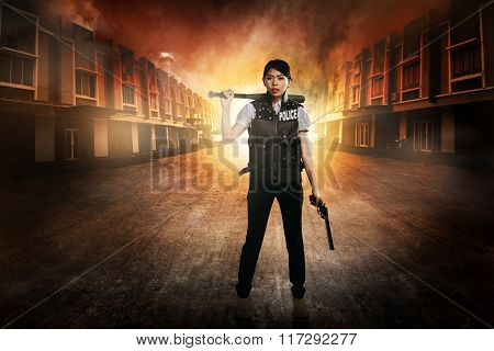 Pretty Woman In Police Vest Holding Baseball Bat