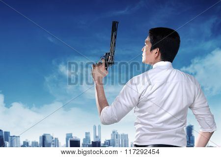 Secret Agent Holding Gun
