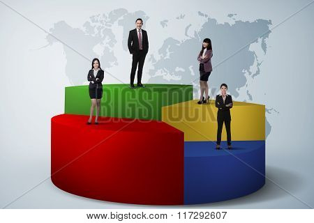 Business Team Standing On Pie Chart