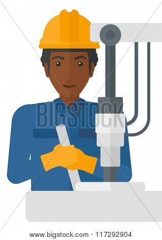 Worker working with industrial equipment.