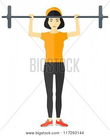 Woman lifting barbell.