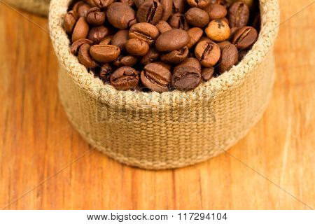 Coffee Beans In Fabric On A Wooden