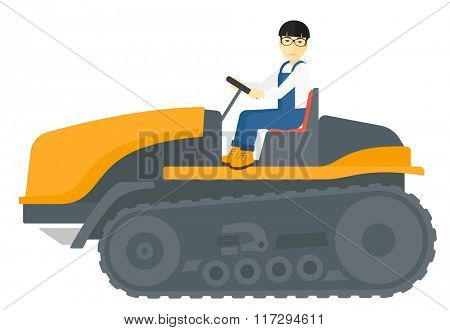 Farmer driving catepillar tractor.