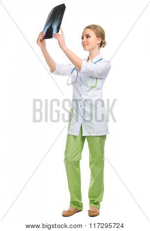Young doctor with X-ray isolated on white