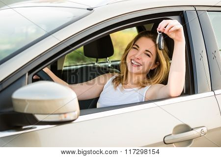 First car - young woman with keys