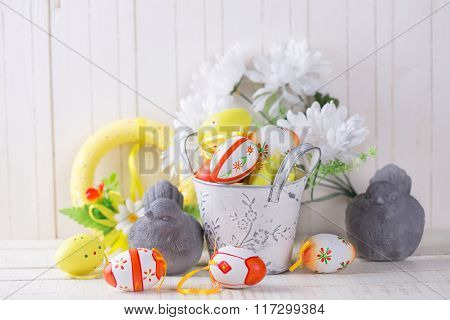 Colorful Easter Eggs And Decorative Birds On White  Wooden Background.