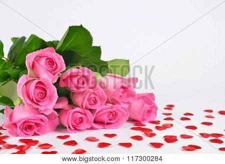 Bouquet of pink roses with a hearts.
