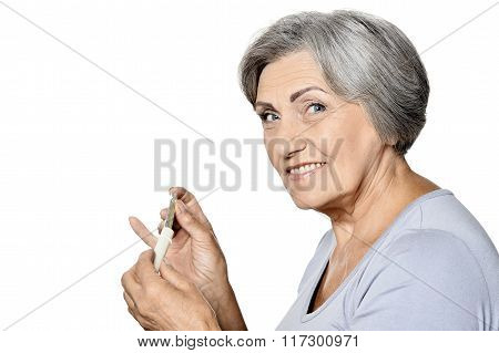 Sick senior woman taking pills isolated