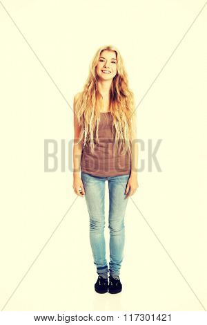 Happy student woman standing