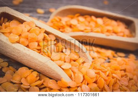 Vintage Photo, Heap Of Red Lentil With Spoon On Wooden Background