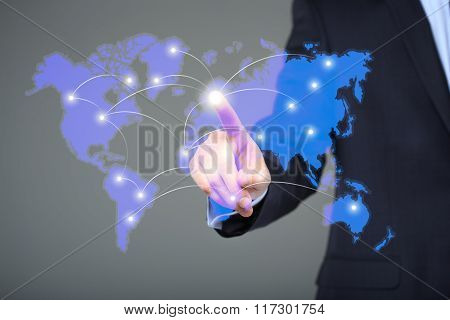 businessman touching a world map on the screen showing global connection between different continent