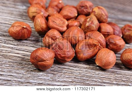 Heap Of Brown Hazelnut On Wooden Table