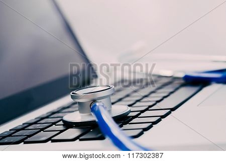 Stethoscope On Laptop - Computer Repair And Maintenance Concept - In Dark Tone