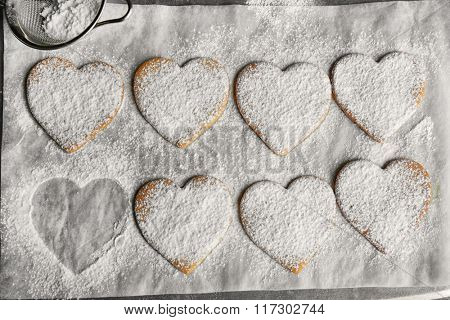 Process of powdering heart shaped cookies