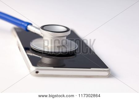 Smartphone Being Diagnosed By Stethoscope - Phone Repair And Check Up Concept