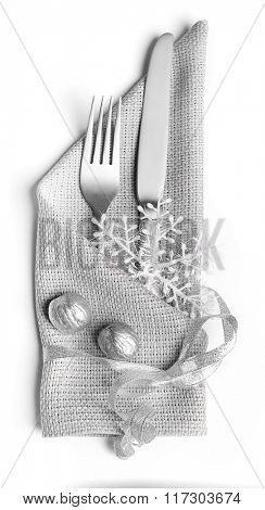 Christmas serving cutlery in a napkin, isolated on white