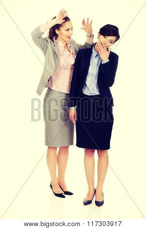 Businesswoman shouting on her tired partner.
