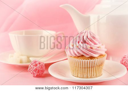 Tasty cupcakes with tea set and decorations, closeup