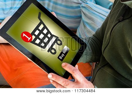 Man Using Tablet To Buy Online