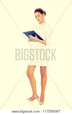 Young businesswoman make a notes