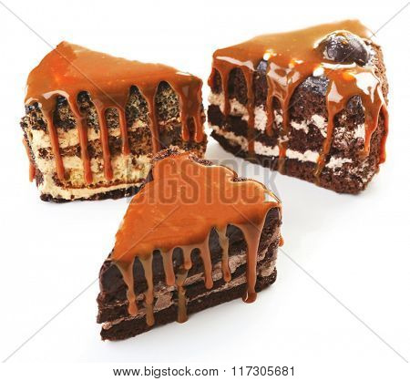 Pieces of chocolate cake with caramel isolated on white