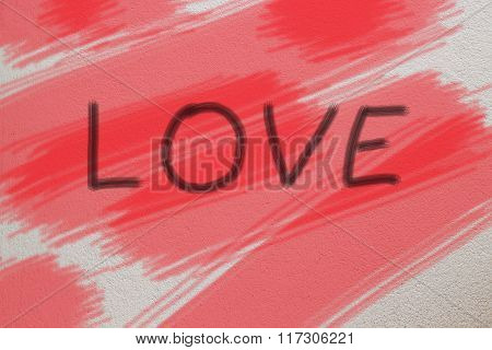 Word LOVE on cement background