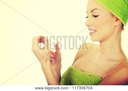 Woman with a nail scissor.