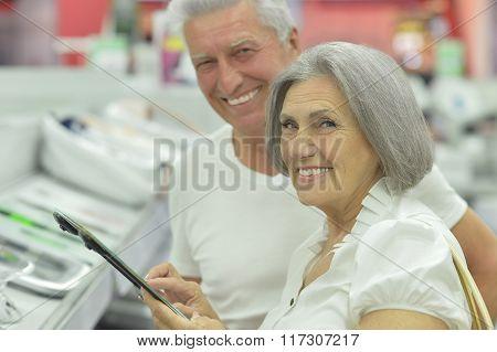 senior couple in  shopping center