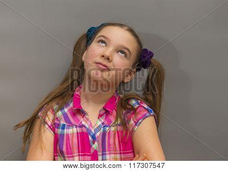 Portrait of beautiful focused pensive casual caucasian teenage girl
