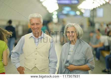 beautiful elderly couple in subway