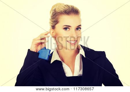 Businesswoman real estate agent with house pendant