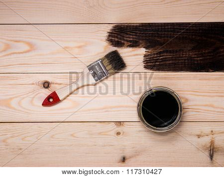 staining wood stain. Brush on wood background