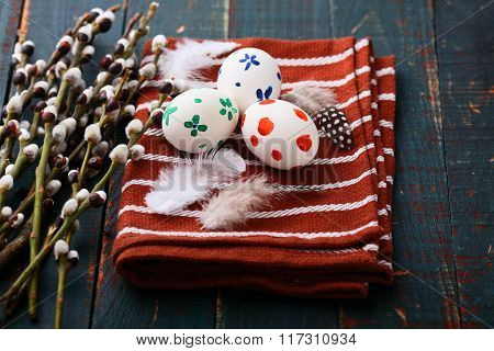 Easter Concept. Painted Eggs On Napkin And Pussy Willow Branches