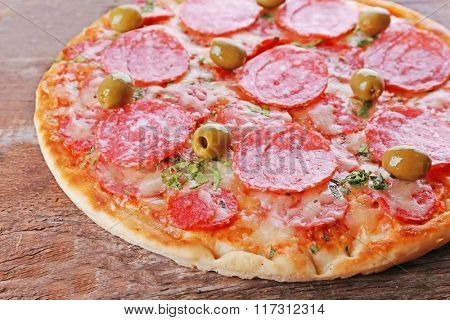 Delicious tasty pizza, closeup
