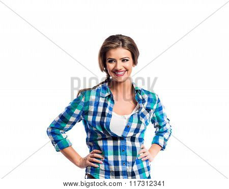 Woman with plait in blue and green checked shirt smiling