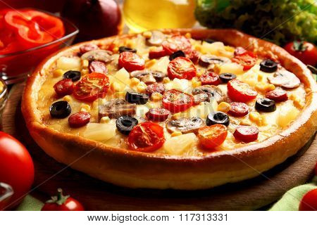 Delicious pizza with vegetables and meat, close-up
