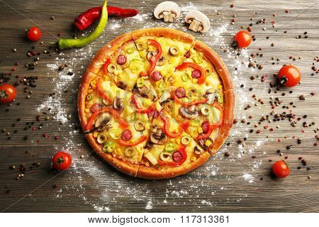 Delicious sliced pizza with vegetables, close-up
