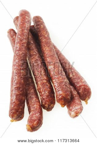 A group of freshly made hot Italian sausage