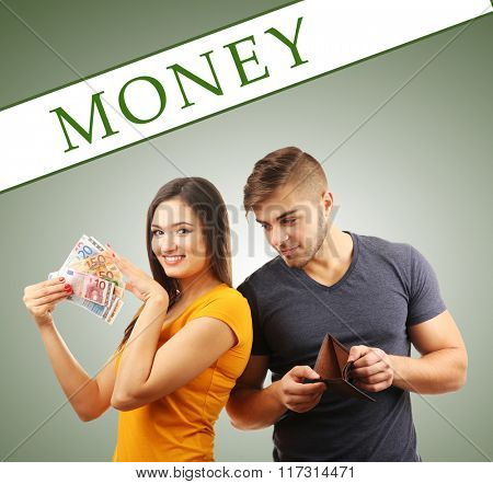 Couple with money banknotes on green background