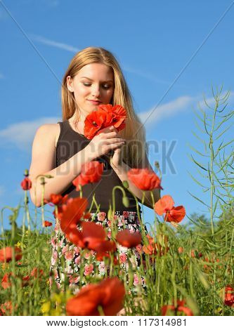 Girl in field with poppies