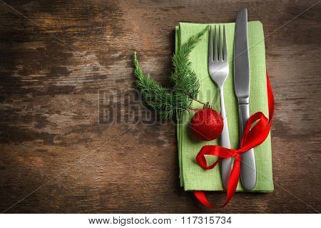 Christmas serving cutlery with napkin on a wooden background