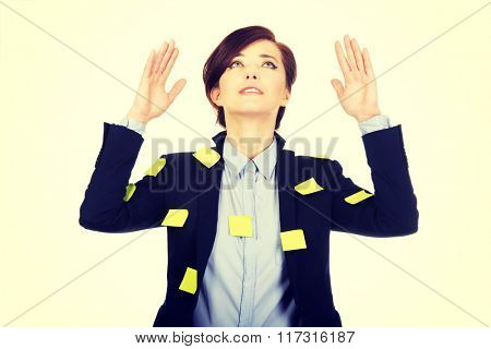 Woman with adhesive cards and hands up.