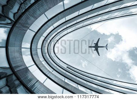 Modern Architecture Building With Landing Airplane