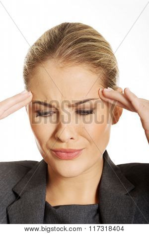 Businesswoman having huge headache