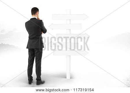 Man Stands And Thinks About Blank Signpost Directions