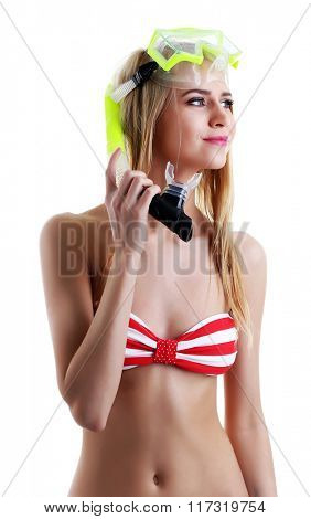 Young beautiful woman posing in red striped swimsuit and diving mask, isolated on white